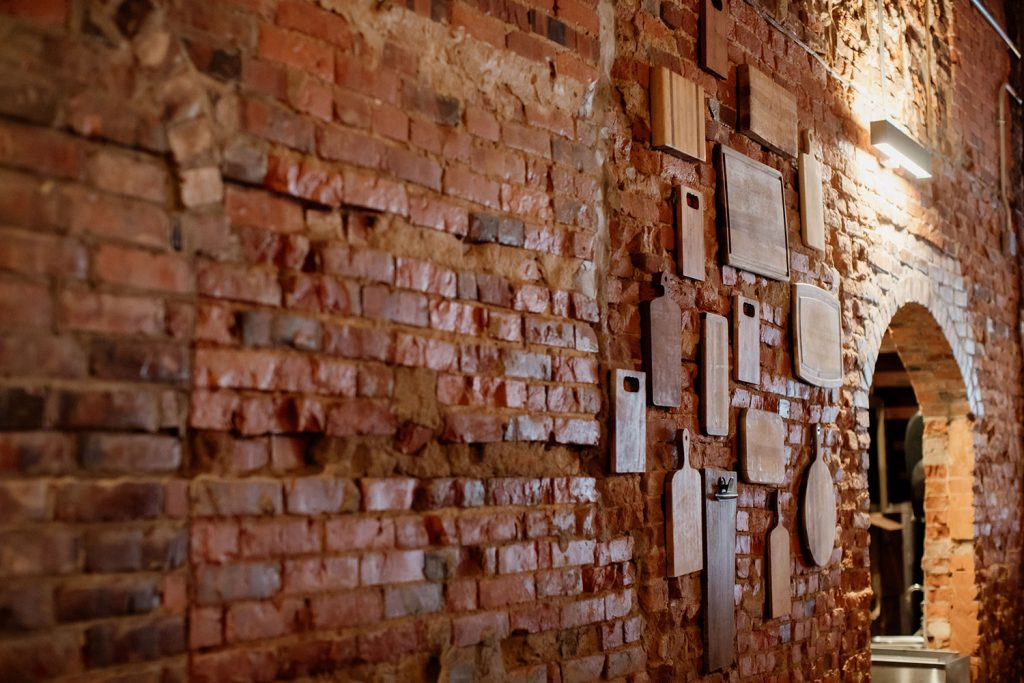 Brick wall with cutting boards