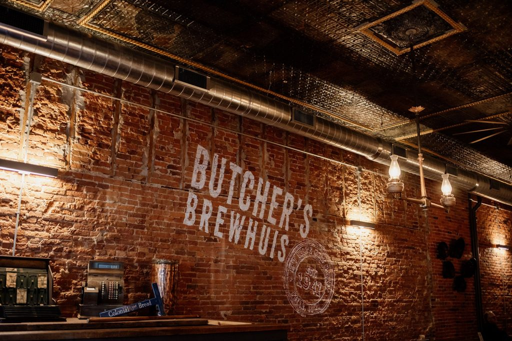 Butcher's Brewhuis logo on wall